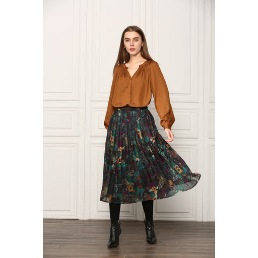 DESCRIPTION  Midi-length skirt in pretty green floral printed pleated fabric. Pairs easy with a simple white graphic tee or satin blouse for a fancier look.   Since 2006, SEE YOU SOON has been developing fashion that's inhibition free, where subtle vintage style is blended with 1960s cuts and revitalized 70s prints, but stays faithful to the sharpest trends.  MATERIALS  100% Polyester  CARE  Dry clean; Gingerly Witty