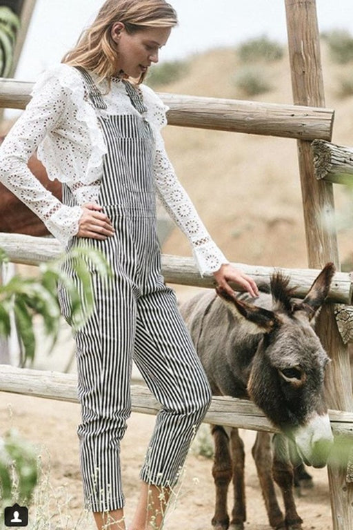 Wear these the next time you take a train! Classic striped overalls in black and white and front and back pockets. Pairs great with an eyelet lace blouse or simple white tee. ; Storia; Gingerly Witty