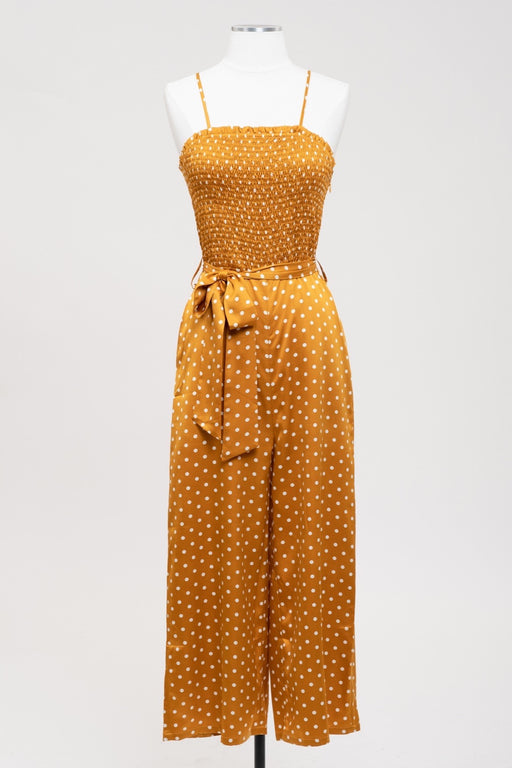 Woven spaghetti strap smocked jumpsuit in a dijon polka dot pattern. ; j.o.a.; Gingerly Witty