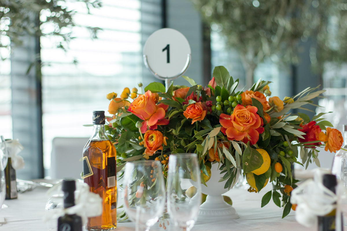 yellow flower centerpiece and wine
