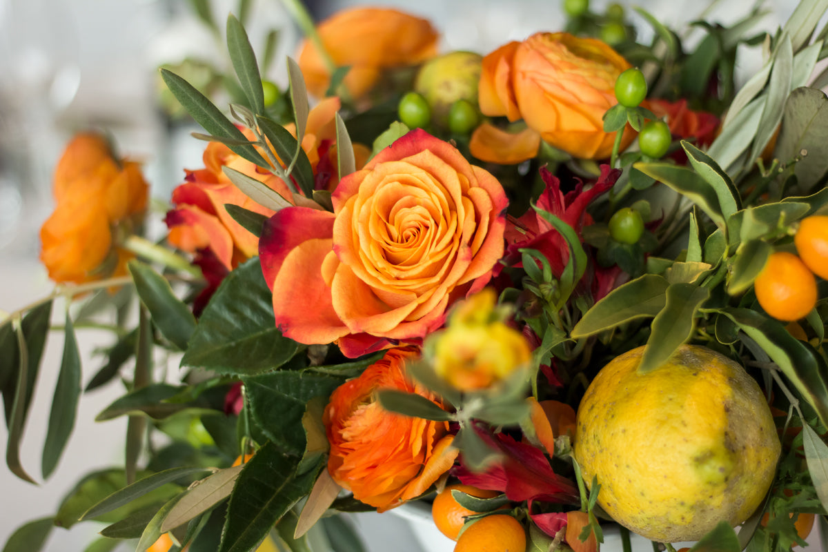 roses and fruits as centerpiece