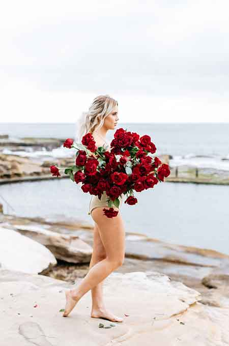 Girl holding red flowers Photographic Print