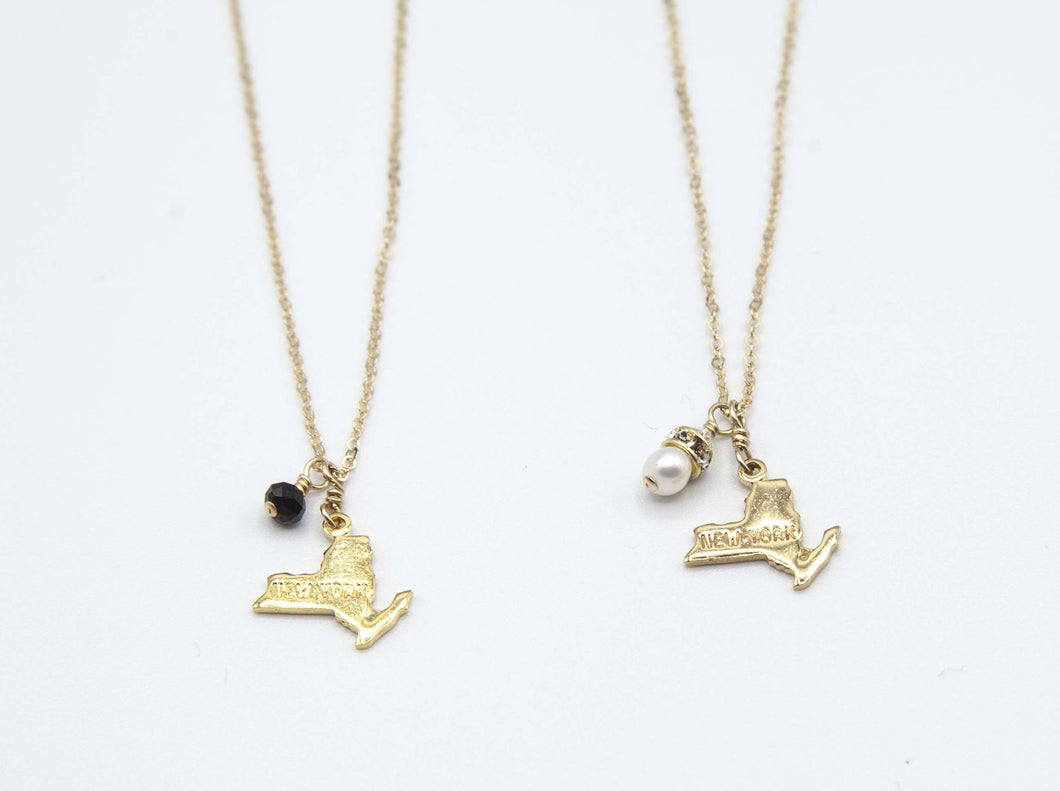 14K Gold plated NY state charm necklace with either pearl or black onyx charm or any color you'd like (also available with no stone). 14k gold fill, non-tarnish, hypoallergenic chain. Quality crafted to last! 16