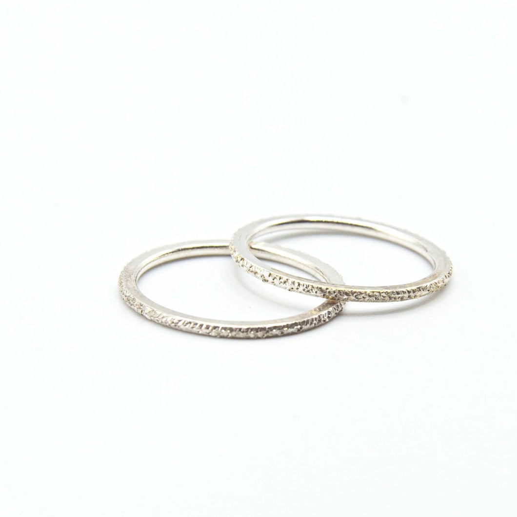 Sterling silver stardust ring, stacking ring. Perfect for layering or just to wear alone. Shower, sleep with it on, it's quality crafted to last and hypoallergenic!