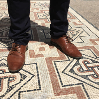 Geometric Roman mosaic floor in a project interior