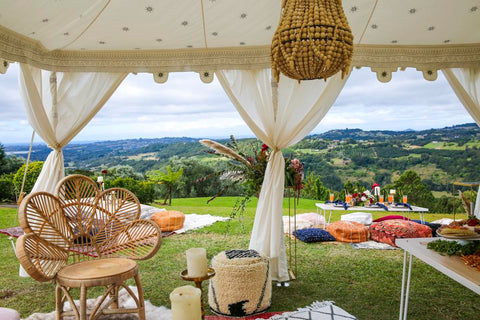 wedding setup at summer grove estate with rugs and cushions and arabian tents by exotic soirees