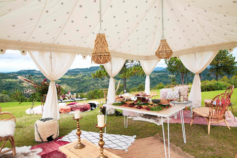 luxury wedding setup in a tent with cushions and rugs