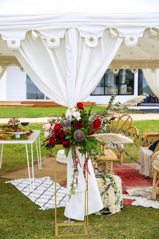 florals around a white indian tent by exotic soirees brisbane