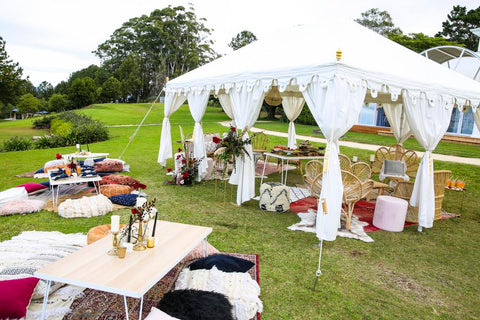 exotic soirees white wedding raj tent and marquee with a bohemian styled setup