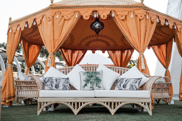 Luxury yellow arabian tent with cane sofa lounge