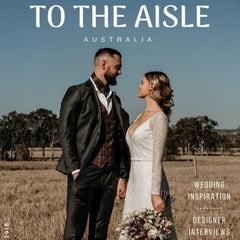 to the aisle front cover article with bride and groom with exotic soirees luxury marquee hire on the gold coast