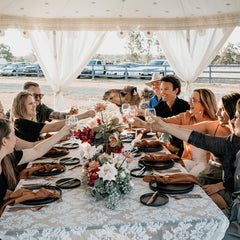 wedding guests under a luxury pavilion marquee canopy with a camel