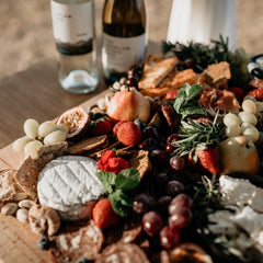 grazing platter with feta cheese and wine