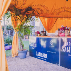 corporate service bar under a yellow saffron tent or marquee