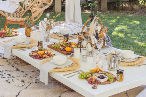 grazing table and dinnerware under a luxury arabian tent from exotic soirees hire
