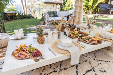 grazing table under a luxury tent from exotic soirees hire