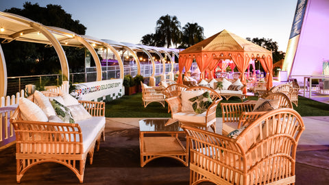 Luxury marquee and cane furniture installation at the gold coast convention and exhibition centre by exotic soirees garden tent hire