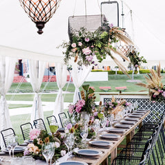 wedding setup on tables under a marquee