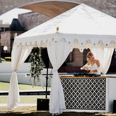 music dj under a white garden tent or marquee