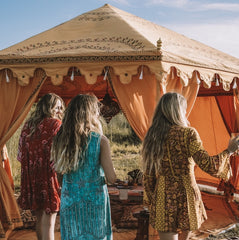 saffron yellow tent with girls dancing