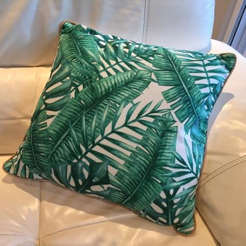 Cushions for hire with tropical green palm frond leaves