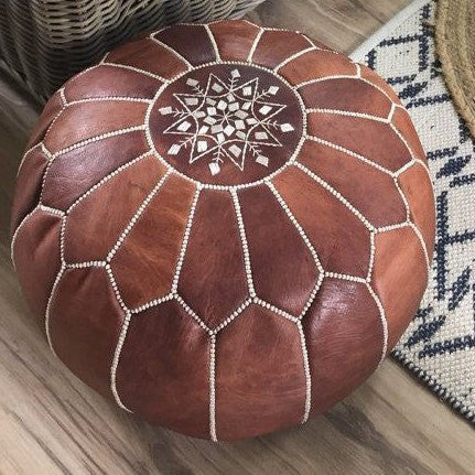 a plush brown leather moroccan pouffe ottoman to hire from exotic soirees luxury marquee hire on the gold coast for parties and special events