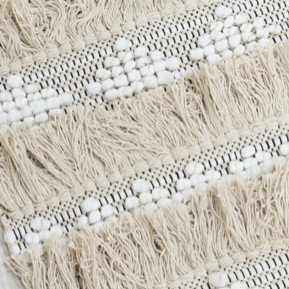 moroccan rug in white and ivory with tassels