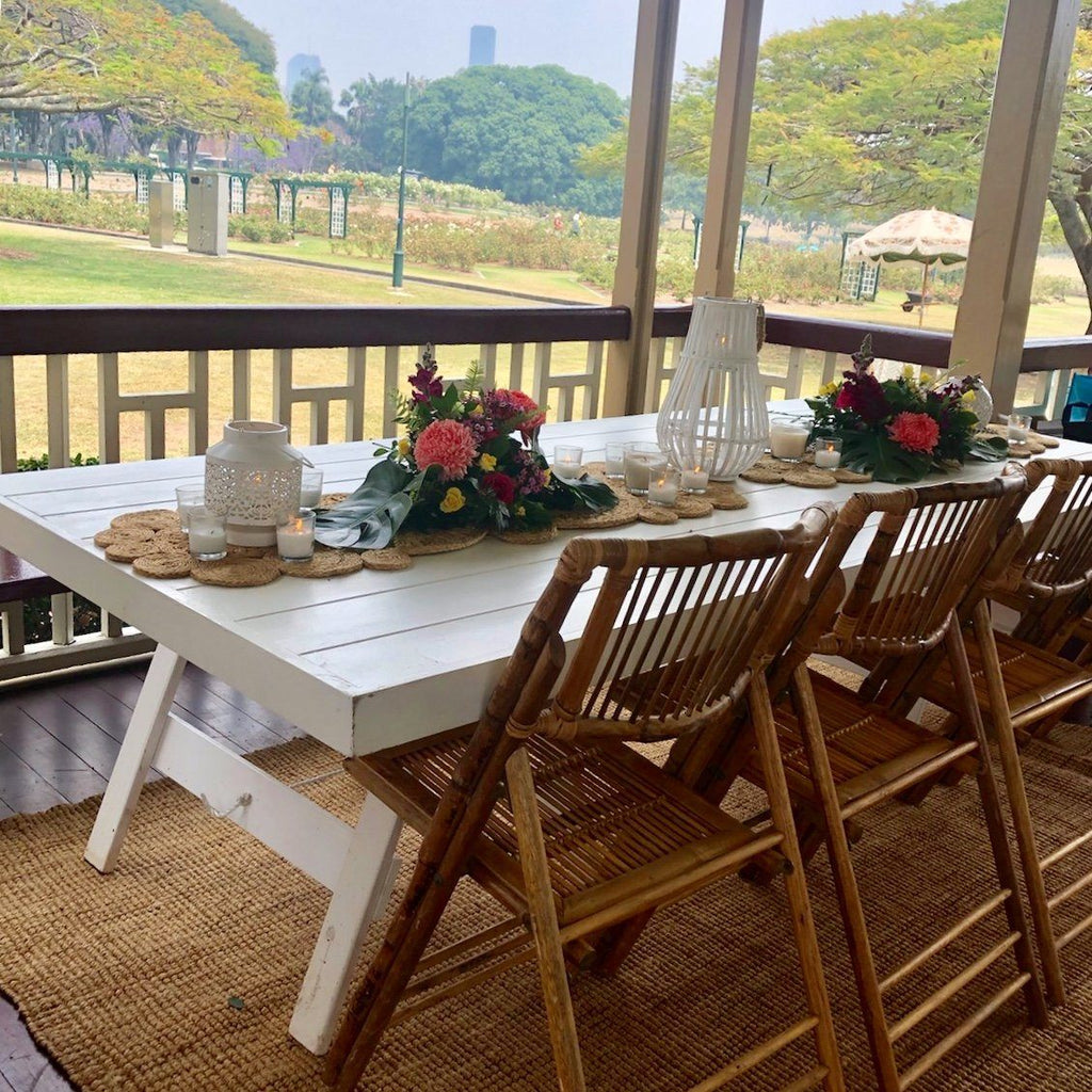 white table and bamboo folding chairs