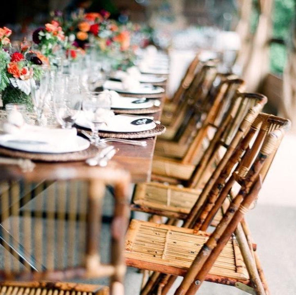 bamboo folding chairs in a wedding reception setup for exotic soirees hire