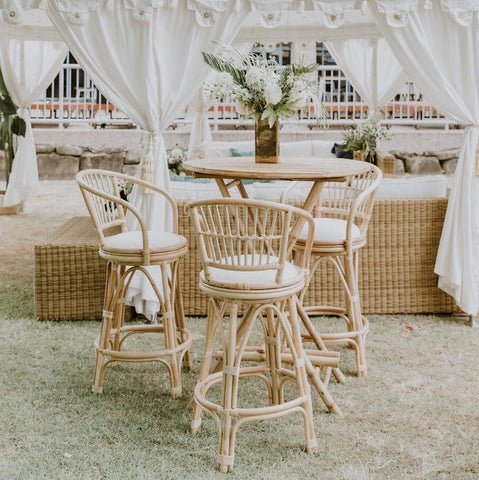 bamboo bar stools matched with bamboo dry bar with padded white cushion in an arabian tent setting