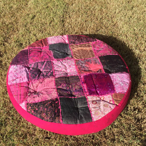 round multi coloured floor cushion for hire from exotic soirees garden tents and marquees on the gold coast and brisbane
