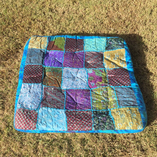 Floor cushion multi colour blue for hire for parties on the gold coast and brisbane