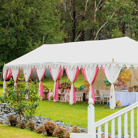 luxury pink and white marquee or tent in a garden setting for a birthday from exotic soirees hire on the gold coast