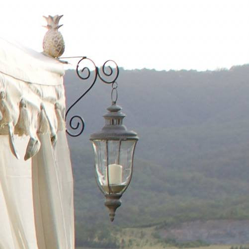 hanging vintage grey rustic salvaged lantern with candle behind glass for hire from exotic soirees luxury marquees and furniture on the gold coast to byron bay
