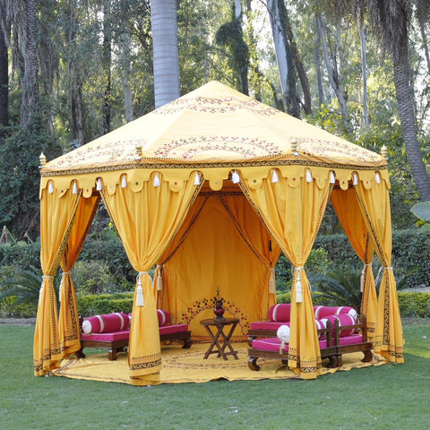 Luxury yellow octagonal shaped marquee for hire, Indian moroccan tipi bollywood in a beautiful garden setting