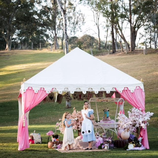 pink and white tent set up for a mad hatters luxury high tea for hire from exotic soirees marquees on the gold coast and brisbane