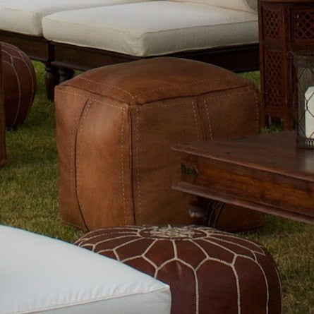 a brown square leather ottoman pouffe for hire from exotic soirees luxury marquee hire on the gold coast for weddings and special events