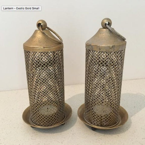 two gold brass moroccan indian lanterns with tea lights inside for hire through exotic soirees luxury marquee hire gold coast and byron bay
