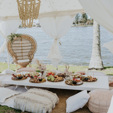 white trestle table with food and marquee