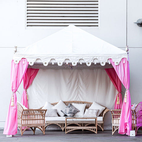 luxury pink tent or marquee with cane furniture for hire from exotic soirees on the gold coast