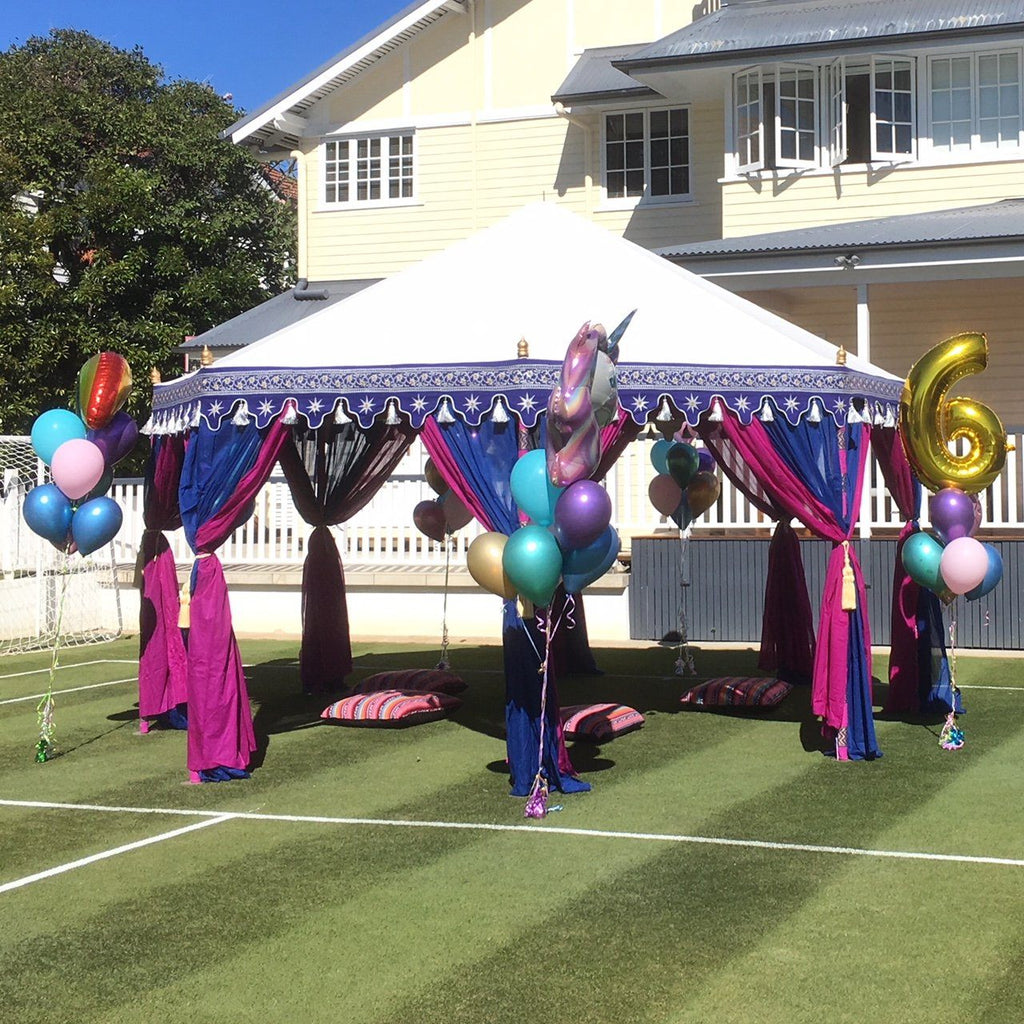 luxury arabian tent marquee tent in pink and purple with white roof on a tennis court with balloons for hire from exotic soirees on the gold coast