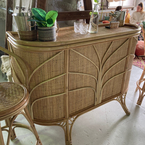 Rattan bar with glasses on the top