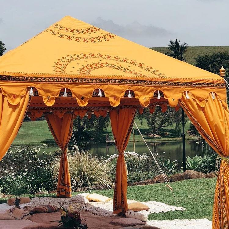 Saffron bollywood arabian marquee with styled flooring, rugs and cushions