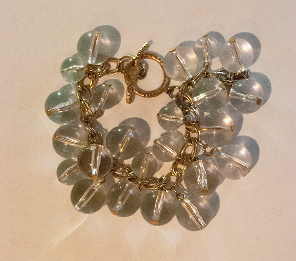 Clear bead and gold chain dangle bracelet