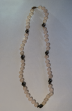 Clear pink and dark charcoal grey round beaded necklace