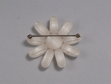 White flower-shaped brooch