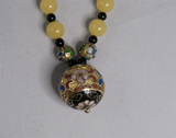 Closionné, yellow, and black bead pendant necklace