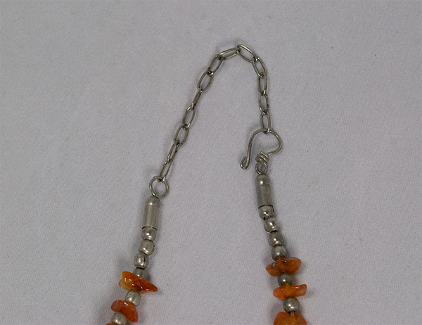 Orange cluster and silver bead necklace