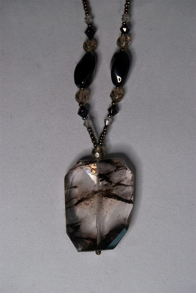 Silver and black stone pendant necklace