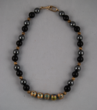 Gold cloisonne, black, and silver bead necklace